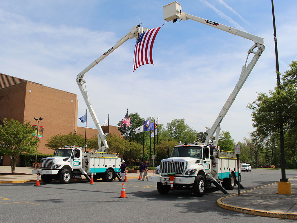 Annual Meeting Trucks with Flag
